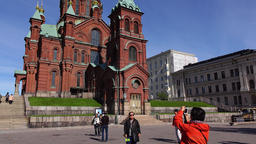 Asian tourists take pictures against Uspenski Cathedral in Helsinki Footage