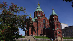 Uspenski Cathedral, red brick Eastern Orthodox church at sunny day Footage