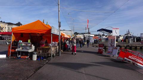 POV walk near harbour market restaurants tents, people on the way Footage