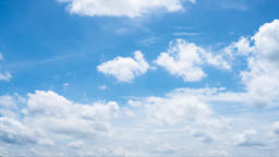 Time lapse clip of white fluffy clouds over blue sky Archivo