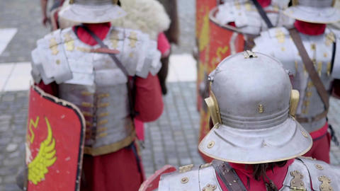 Roman legionaries column dressed in armor that marches and that stops to their c Footage