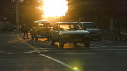 Classic cars in the sunset glow silhouettes in Havana Footage