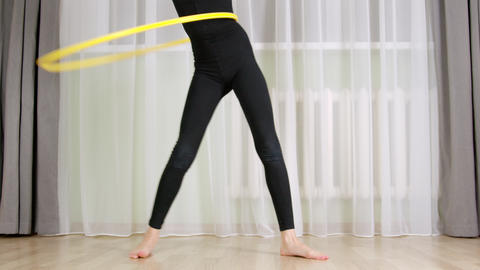 Cropped partial view of girl training with hula hoop Live Action