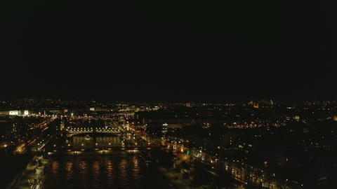 AERIAL: View over Seine River at Night in Paris, France with View on Eiffel Live Action