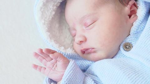 Infancy, childhood, care, kids concept - close up portrait of a newborn baby Live Action