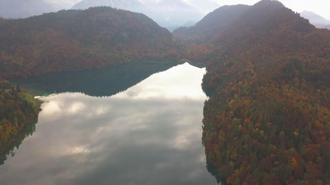 AERIAL: Flight over Mountain Lake in Europe,german Alps with Reflection and Live Action