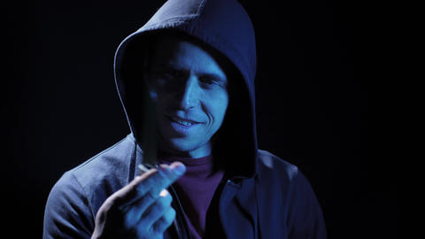 Angry criminal with a knife in his hand Live Action