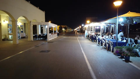 Night walking at marina, illuminated harbor facilities and restaurateurs Live Action