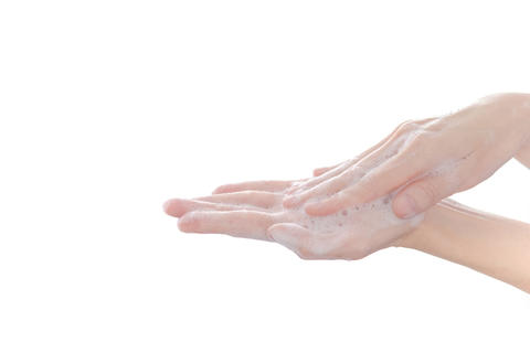 Hand wash with soap isolated on white background Photo
