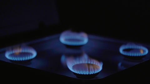 Close-up of a fire in a gas stoker on a gas stove Live Action