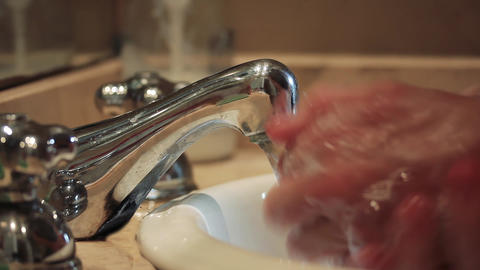 Man washing Hands at the Bathroom Sink. COVID-19 Prevention Live Action