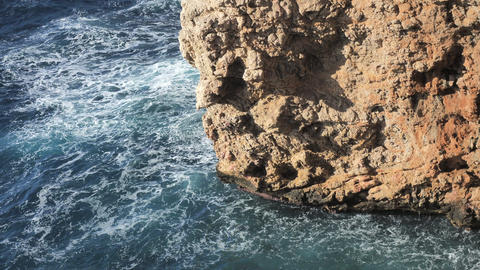 View over sharp cliffs and wild coastline at Calo den Monjo, Mallorca, Spain Live Action