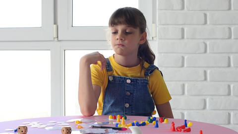 Girl alone plays board games at home Live Action