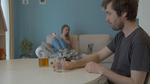 Drunk husband pours whiskey and smokes Live Action