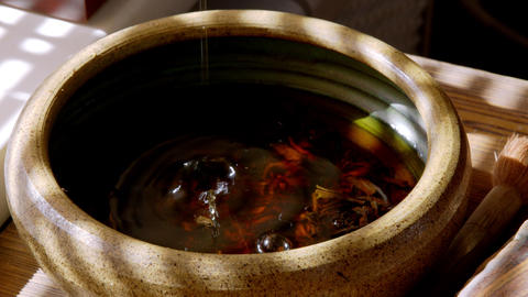 Close up view of tea pouring in tea bowl GIF