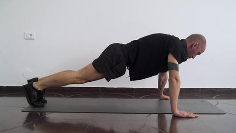 Sport at home. Workout at home. Man doing exercises in the plank. Abdominal Live Action