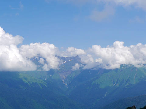 The peaks of the mountains behind the clouds. Ridge Aibga. Sochi, Russia Footage