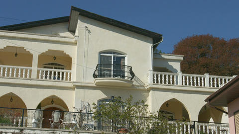 Close look at beautiful balcony of expensive mansion. Zoom out. Luxury residence Footage