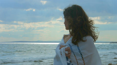 Horizontal panorama of stormy sea and beautiful lonely woman standing on beach Footage