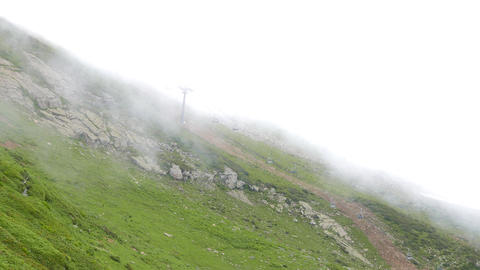 Clouds on the slope. Cableway. Ridge Aibga. Sochi, Russia Footage