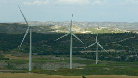 Wind turbine propellers rotating. Green energy generation. Amazing landscape Footage