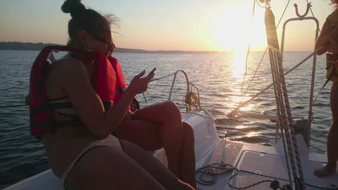 Beautiful girls having fun, enjoying trip on yacht, talking, summer cruise Footage