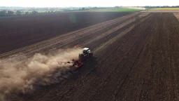 Cultivation soil: farm tractor plowing cropped field after harvesting HD aerial  Footage