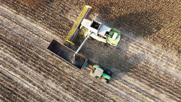Harvester unloads sunflowers seed farm vehicle HD video aerial top view field Footage