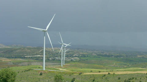 Wind farm in green field, wind turbines spinning, alternative energy sources Footage
