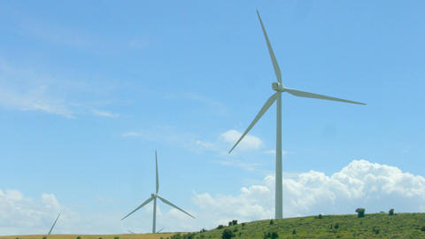Wind turbines rotate, amazing blue sky background, alternative energy innovation Footage