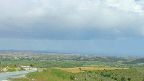 Beautiful pan of summer field, green hills, wind farm generating electricity Footage