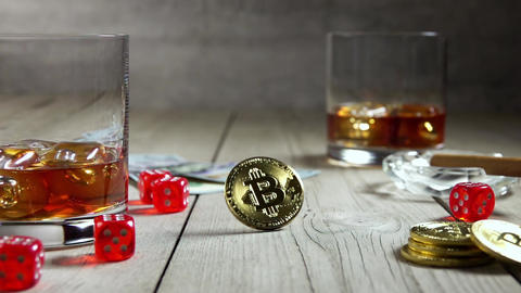 Still Life With Glasses of Whiskey and Bitcoin. Slow Motion Live Action
