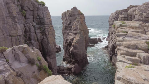 Awesome cliff and rock formations of geological layers and huge crevasses with stone column until Live Action