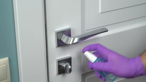 Clean and disinfect door handle. Coronavirus Live Action