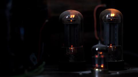 Retro vacuum tube amplifier in dark Live Action