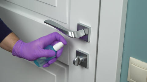 Cleaning door handles with an antiseptic, COVID-19 Live Action
