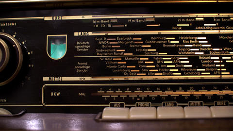 Searching station on retro radio Live Action