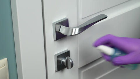 Cleaning door handles with an antiseptic Live Action