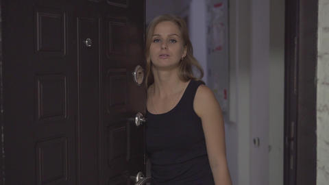 Beautiful girl at the front door of the house. The blonde leaves the house and Live Action