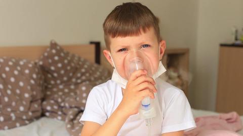A child with an inhaler. Boy got sick Live Action