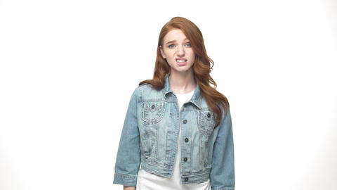 Beautiful young unhappy clap hands while standing isolated on white Live Action