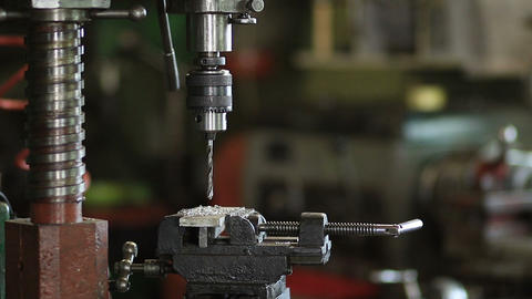 Old vertical drilling machine in workshop Footage