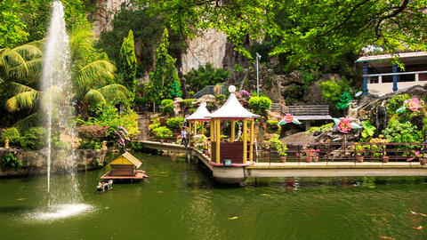 Pond with Fountain Embankment with Pavilions in Batu Caves Footage
