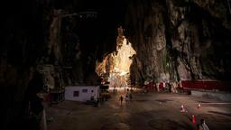 People Walk around Large Square Inside Batu Caves Footage