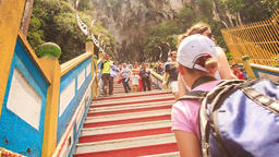 Closeup Tourists Go up Down Steps to Batu Caves Entrance Footage
