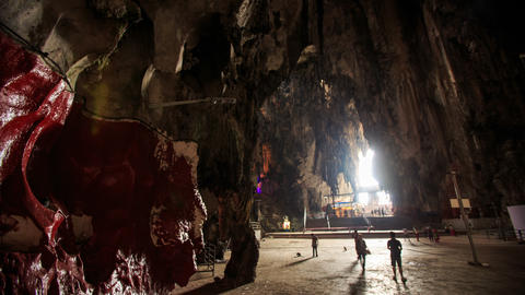 Interior View of Dark Rocks with Sun Rays inside Batu Caves Footage