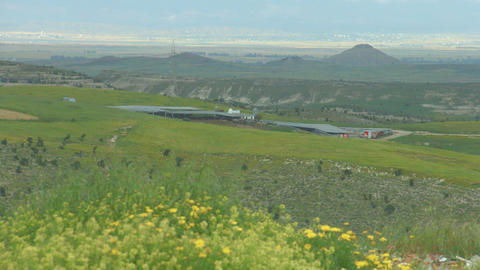 Beautiful field with flowers, hills, amazing landscape panorama, natural beauty Footage