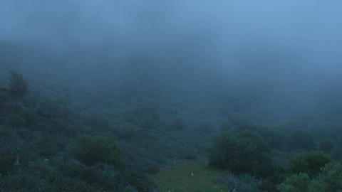 Time-lapse of night in mountains, foggy dangerous landscape, frightful darkness Footage