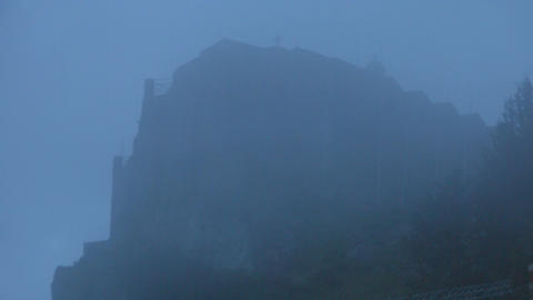 Mysterious haunted castle, church on top of mountain hidden in fog, horror film Footage