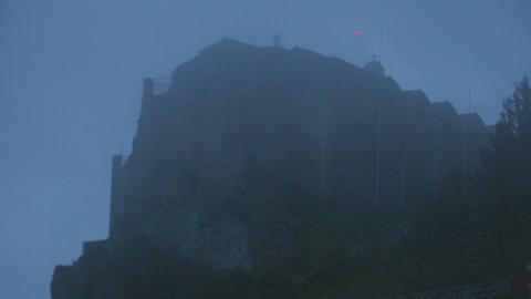 Time lapse of mist covering old stone church on mountain, mysterious atmosphere Live Action